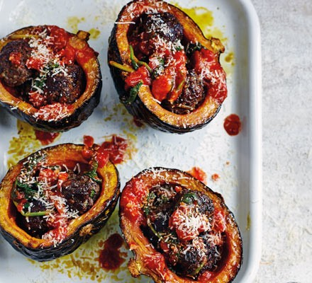 Meatball-stuffed squash with spinach sauce