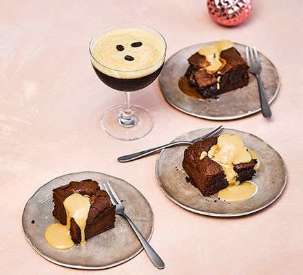 Three espresso martini brownies on decorative plates