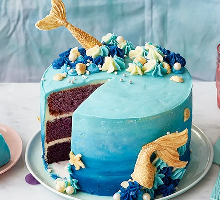 Mermaid cake with a slice cut out