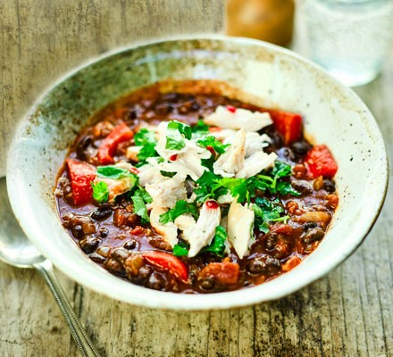 Mexican-style bean soup with shredded chicken & lime