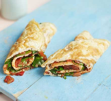 A Mexican egg roll sliced into two halves