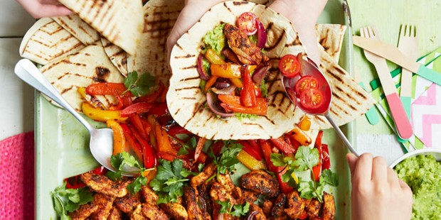 Mexican chicken fajitas being filled