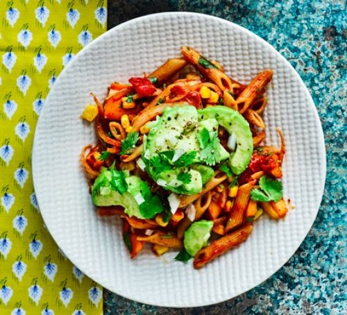 Penne in tomato sauce topped with sliced avocado