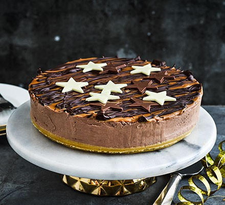 Millionaire's cheesecake served on a cake stand