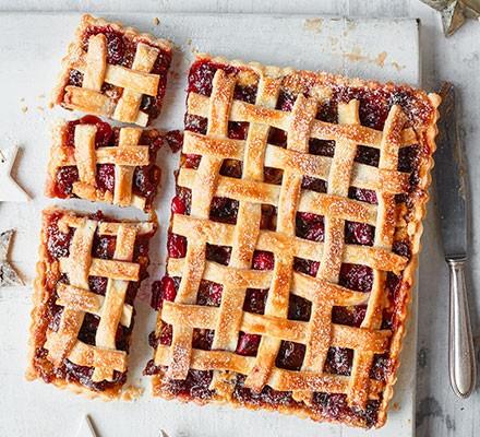 Mincemeat, cranberry & almond pie cut into slices