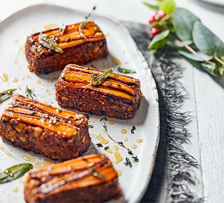 Four mini nut roasts with candied carrots served on a plate