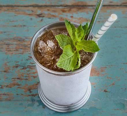 A jar serving a mint julep cocktail