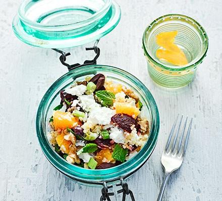 A jar filled with minty beetroot, feta & bulgur salad