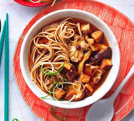 Miso mushroom & tofu noodle soup served in a bowl