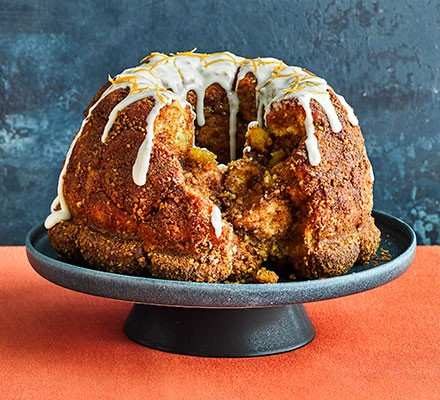 Carrot cake monkey bread served on a cake stand