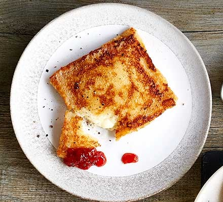 Mozzarella-stuffed French toast served on a plate with chilli sauce