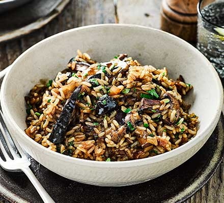 A bowl serving slow cooker mushroom risotto