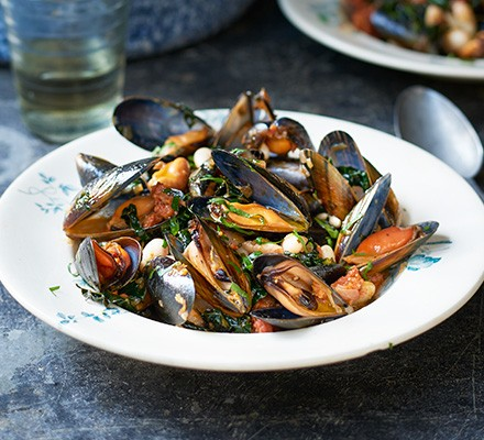 Mussels with chorizo, beans & cavolo nero served in a bowl