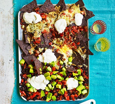 pan of nachos on blue table