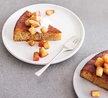A plate serving apple & almond cake