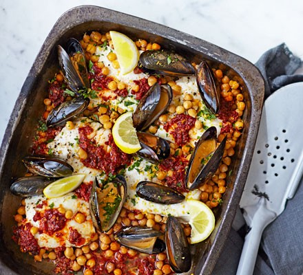 Nduja-baked hake with chickpeas, mussels & gremolata