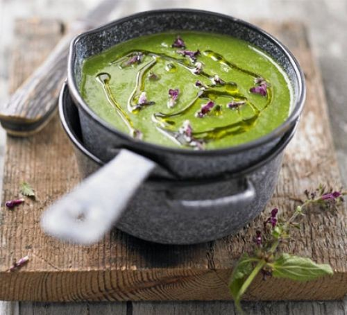 Saucepan of nettle soup topped with nettle flowers