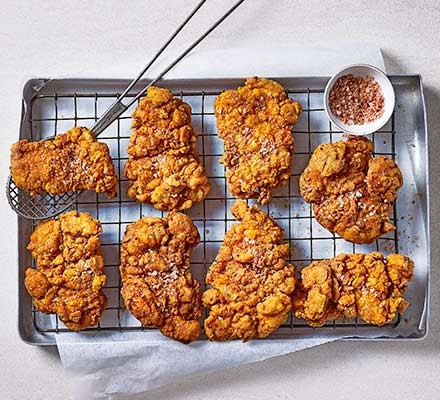 Next level fried chicken on a wire tray