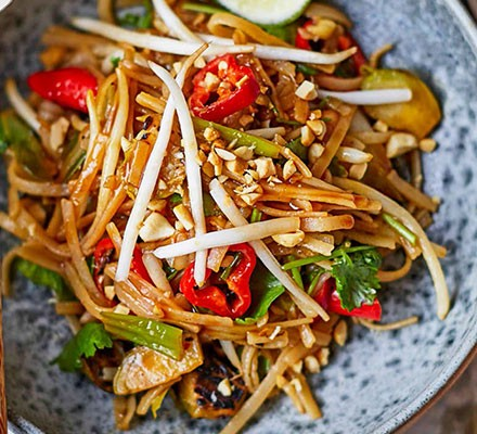 A bowl serving Brussels sprouts pad Thai
