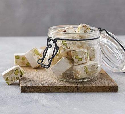 Classic nougat cut into squares and stored in a jar