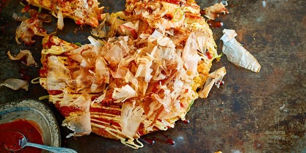 Japanese pancake with sauce and seasoning