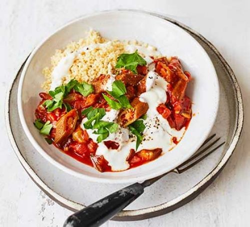 Bowl of okra with tomato sauce and couscous