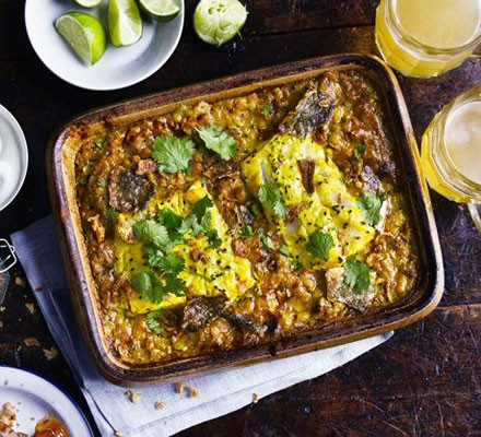 One-pan lentil dhal with curried fish & crispy skin