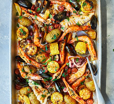 One-pan seafood roast with smoky garlic butter served in a roasting tray