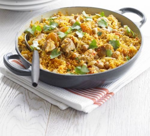 Chicken and couscous in a wide pan