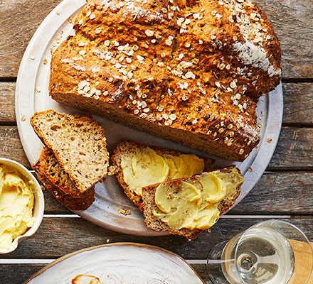 Onion soda bread with whipped English mustard butter served on a plate