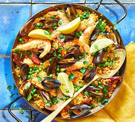 Paella mixta in a large frying pan