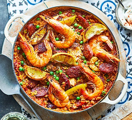 Paella served in a casserole dish