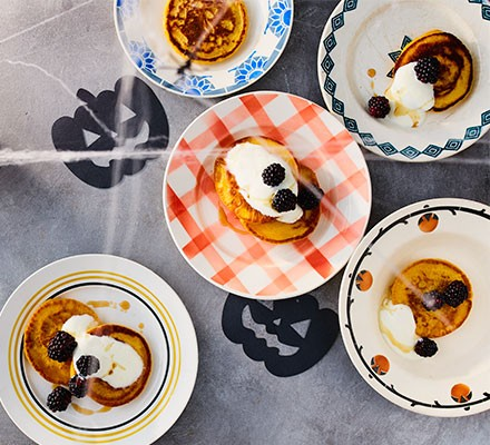 Healthy pumpkin pancakes served in assorted dishes