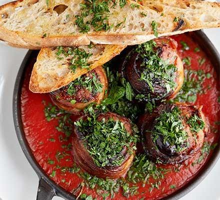 A dish serving pancetta, date & chorizo meatballs