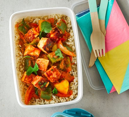 Paneer jalfrezi with brown rice in a lunch box
