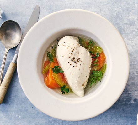 Poached chicken breast in a bowl with veg