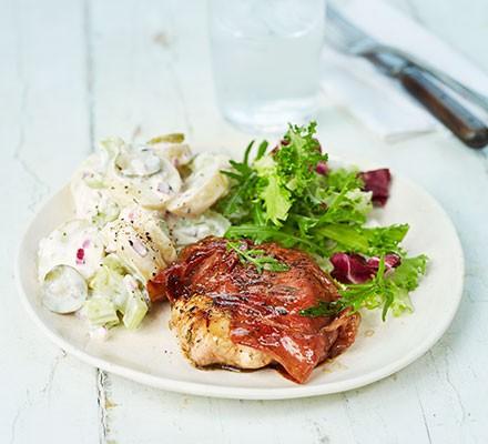 A plate serving parma pork with potato salad