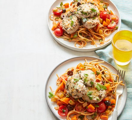 Tomato and olive spaghetti topped with pork