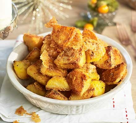 A bowl serving parmesan roasties