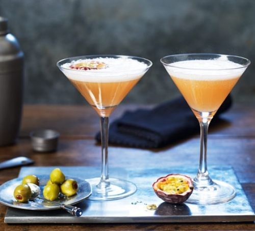 Two cocktail glasses of passionfruit martini