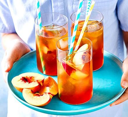 Peach iced tea served on a tray