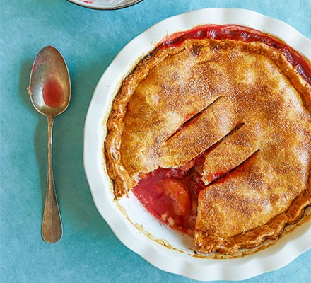 Peach Melba pie served in a dish with a spoon