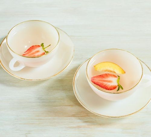 Strawberry and pea tea in teacups