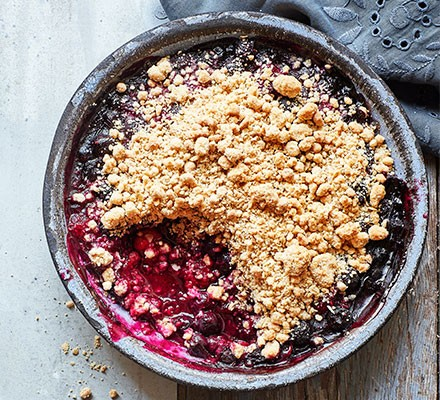 A dish serving peanut butter berry crisp