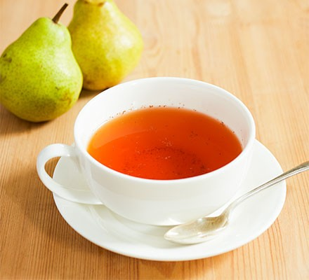 Rooibos & pear tea served in a teacup