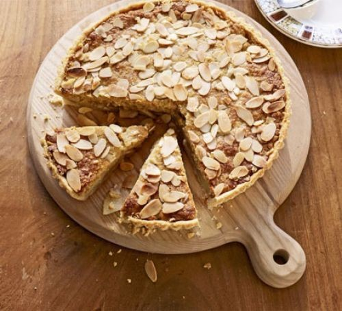 Almond and pear frangipane tart topped with flaked almonds