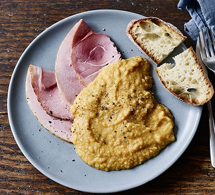 Pease pudding served with ham and bread