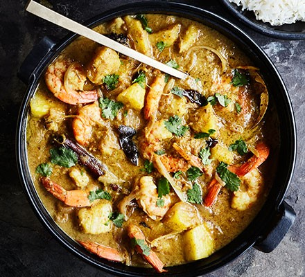 A pan serving Penang prawn & pineapple curry