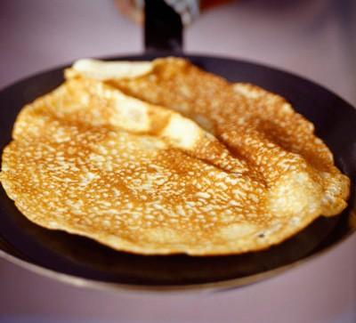 golden pancake in a frying pan