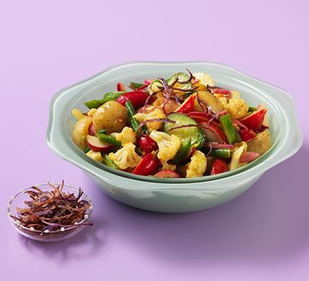 Piccalilli potato salad served in a decorative bowl